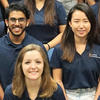 Student employees in blue shirts